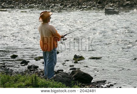 Female Senior Citizen Fishing