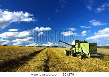 old harvest machine working on the agriculture field