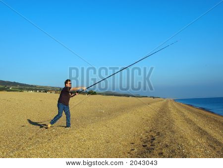 Angler Casting From A Shingle Beach