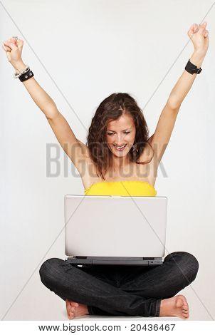 Happy girl on laptop