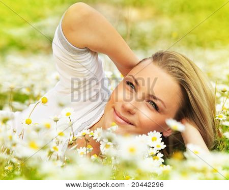 Beautiful Female Laying On The Flower Filed