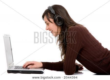 Girl Listening To Music On A Laptop