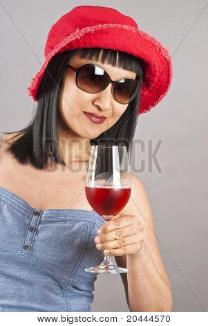 Asian Woman Wearing Sunglasses and Holding a Glass of Wine