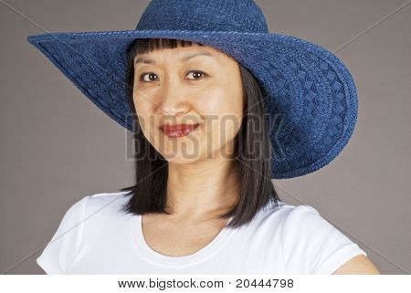 Asian Woman Wearing a Straw Hat