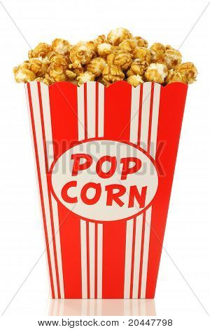 caramel popcorn in a decorative paper popcorn cup