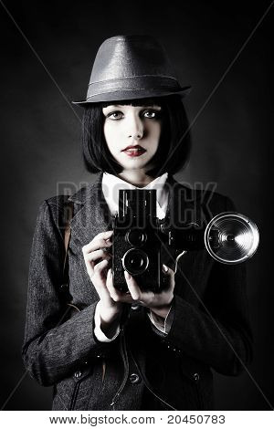 Young Woman And Retro Camera