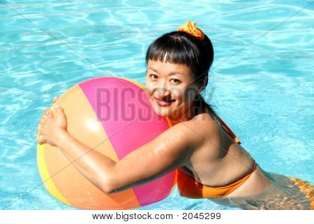 Asian Woman With A Beach Ball