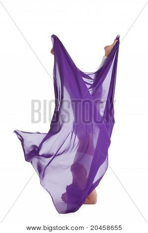 woman with flying purple cloth walking in the air