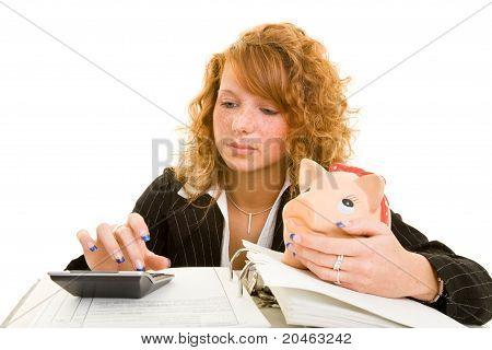 Woman Calculating And Saving Money