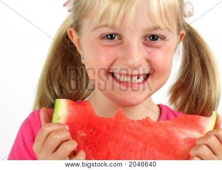 Smiling Girl Eating Melon