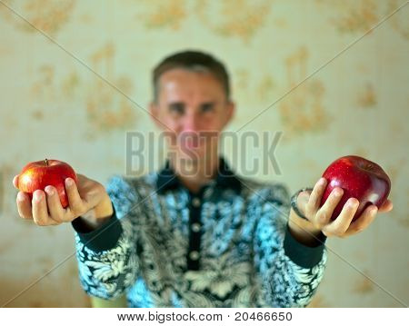 Red apple on man hand