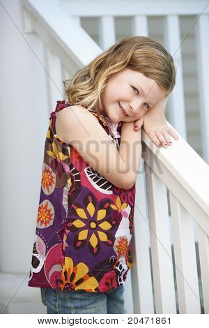 Cute Girl Leaning On Railing