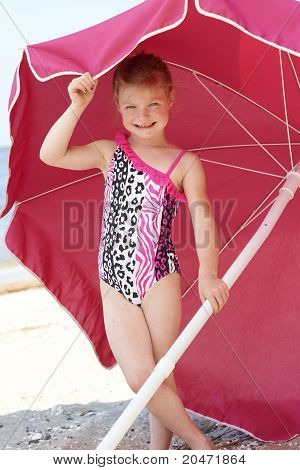 Cute Girl Under Beach Umbrella