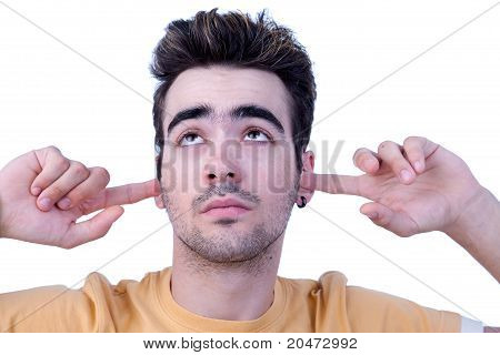 Young Man, Holding Fingers In His Ears, Bored, Not Listening, On White, Studio Shot