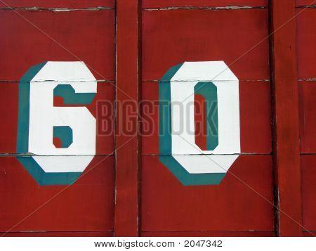 Número 60 en madera pintadas