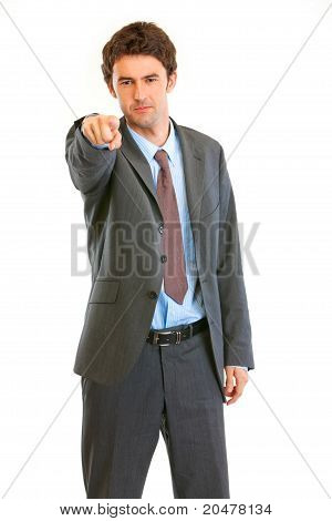 Serious modern businessman pointing finger at you isolated on white