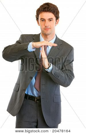 Confident young businessman time out crossed arms isolated on white