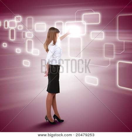 young girl touching a virtual surface
