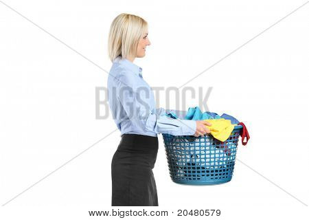 Young woman carrying a laundry basket isolated on white background
