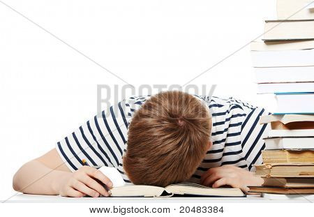 Tired student at the desk, isolated on white