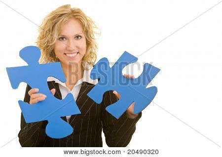 Woman Holding Jigsaw Pieces