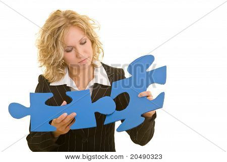 Business Woman Connecting Jigsaw Pieces