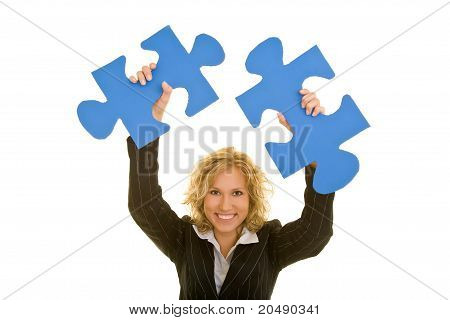 Woman Cheering With Jigsaw Pieces