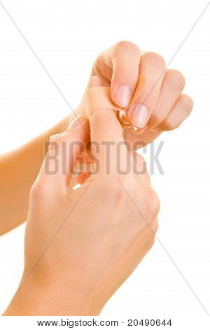 Woman Applying Bandaid