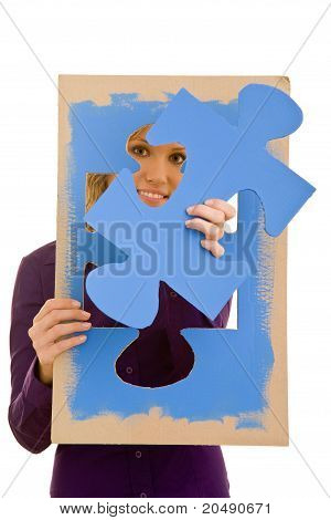 Woman Solving Jigsaw Puzzle