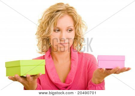 Young Woman Comparing Two Different Gifts