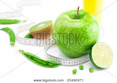 Juice,apple,lime,peas,kiwi And Measure Tape Isolated On White