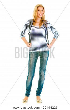 Full length portrait of smiling teen girl with schoolbag on back isolated on white