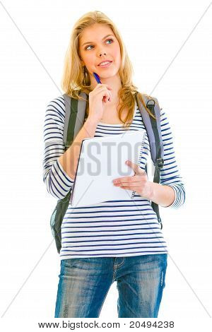 Pensive teengirl with schoolbag holding notebook and pen in hands isolated on white