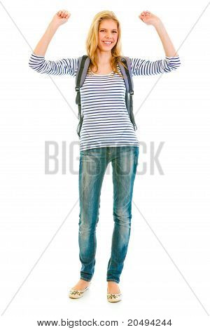 Full length portrait of pleased teengirl with schoolbag enjoying her success isolated on white