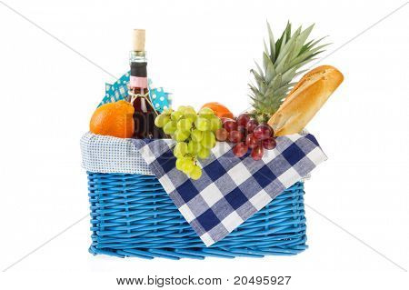 Picnic basket with bread fresh fruit and wine