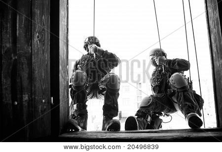 Subdivision anti-terrorist police during a black tactical exercises. Rope Techniques.  Real situatio
