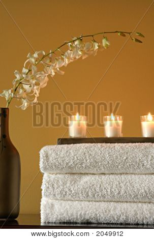 Spa Towels, Candles And Vase With Flowers