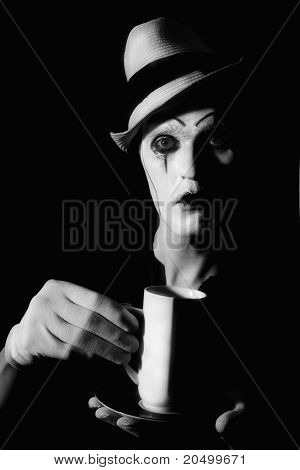 Mime Clown Holding White Cup