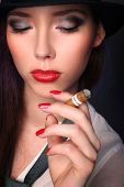 beautiful young woman smoking cigar