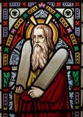 picture of covenant  - detail of victorian stained glass church window in Fringford depicting Moses with the tablets of covenant in his arms interestingly without text means he is pictured before climbing Mount Sinai - JPG