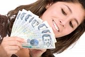 foto of colombian currency  - beautiful girl with lots of money  - JPG