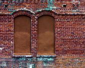 stock photo of ybor city  - boarded up windows in an old brick building in ybor city - JPG