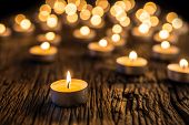 Candles Light In Advent.. Christmas Candles Burning At Night. Golden Light Of Candle Flame poster