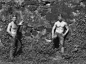 Muscular Twins On Stony Wall Backdrop poster