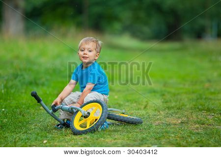 Happy boy on a bicycle