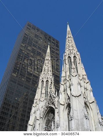 Spires of St. Patrick's Cathedral contrast with modern skyscraper