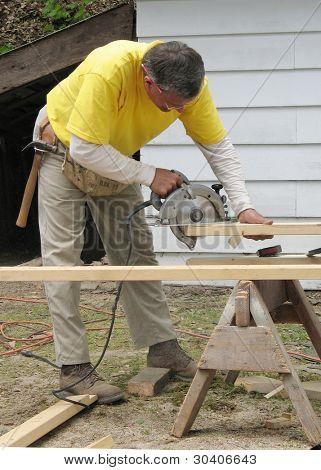 Carpenter using a circular saw
