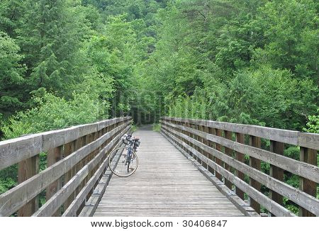Bicycle parked on bridge on rail-trail