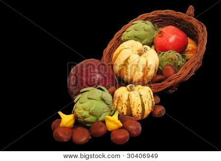 Cornucopia with pomegranate, artichokes, squash, cabbage and chestnuts