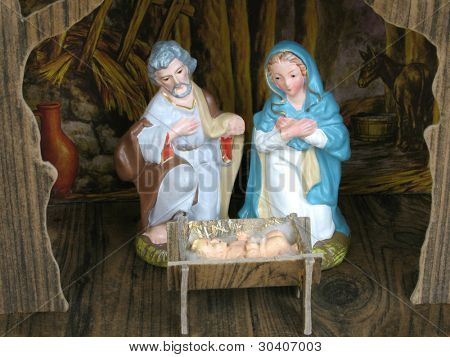 Vintage figurines of Mary, Joseph and Baby Jesus in stable